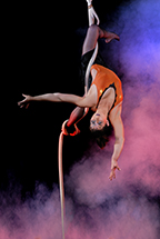 Female Performer hanging upside down from rope